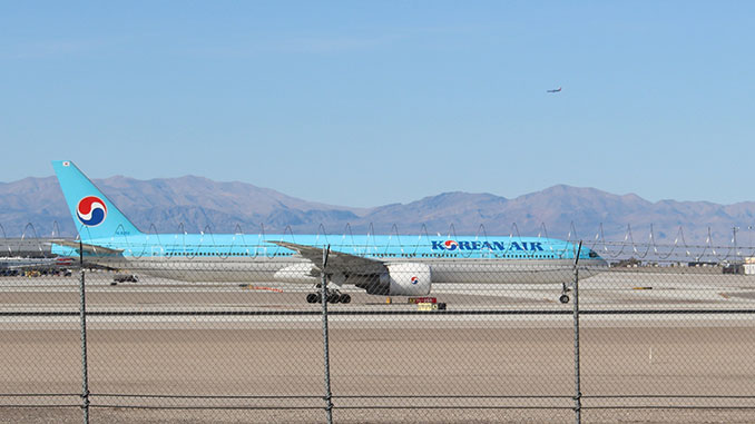 Korean Air Jet taxiing down runway