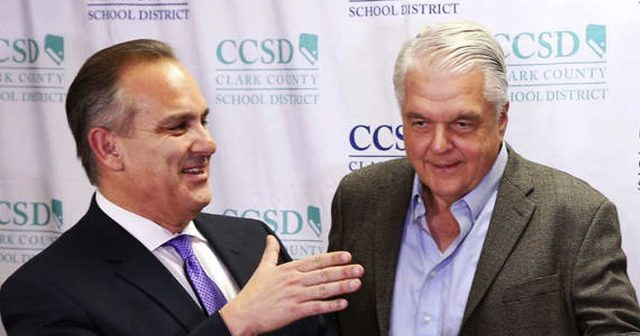 Steve Sisolak with Clark County School District superintendent Jesus F Jara